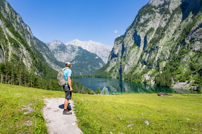 Hiking in the alps near Berchtesgaden at the Obersee, Koenigssee, Bavaria, Germany